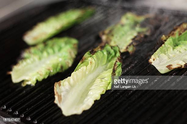 Seared Romaine lettuce on griddle