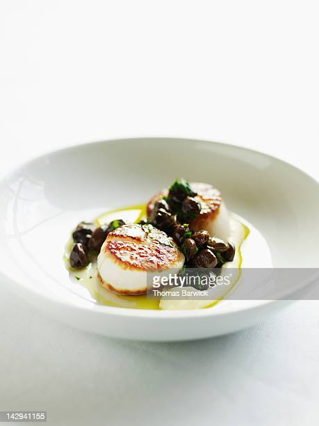 Seared sea scallops with artichoke puree