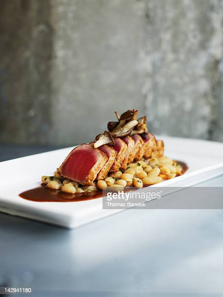 Seared spiced tuna with cannellini beans