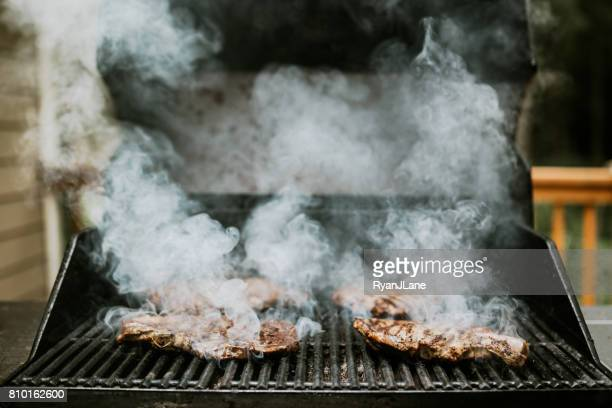 seared steaks on the grill - seared stock photos and pictures