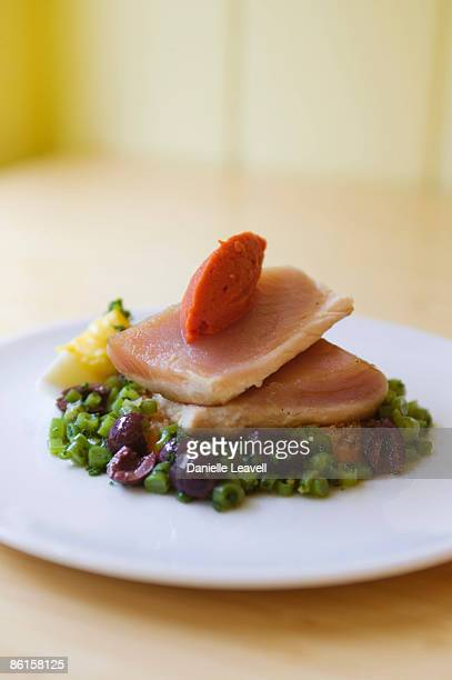 Seared yellowtail with olive and herb salad