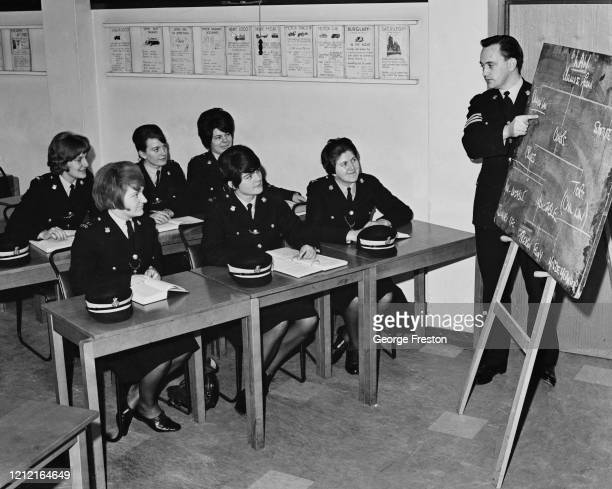 Seargeant Smith instructing a group of female police cadets on the structure of English law during their training at Nottingham City Police...