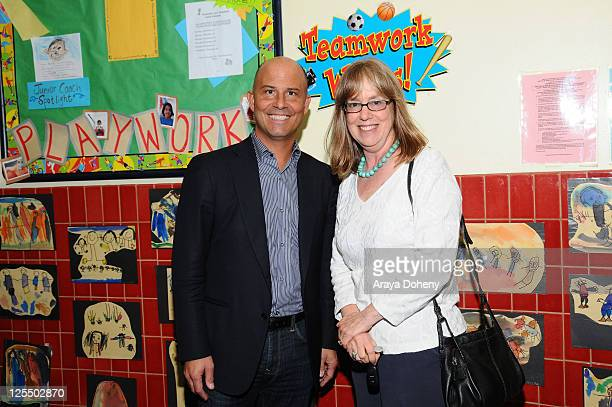 Sears Executive Vice President John Goodman and Midge Wilson of the Bay Area Women's Center tour the Tenderloin School on November 22 2010 in San...