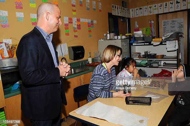 Sears Executive Vice President John Goodman tours the Tenderloin School on November 22 2010 in San Francisco California