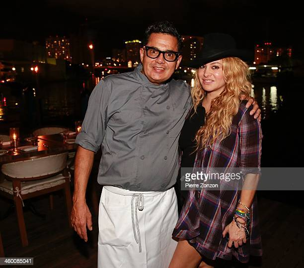 Seasalts Executive chef Alfredo Alvarez and singer Paulina Rubio pose for a photo at Salt and Pepper on January 1 2014 in Miami Florida