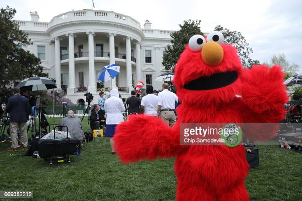 Seasame Street's Elmo makes an appearance during the 139th Easter Egg Roll on the South Lawn of the White House April 17 2017 in Washington DC The...