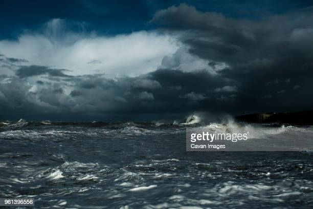 seascape against sky during thunderstorm at night - tempesta foto e immagini stock