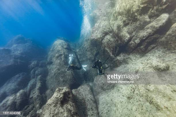 seascape and diving of port-cros national parc - underwater film camera stock pictures, royalty-free photos & images
