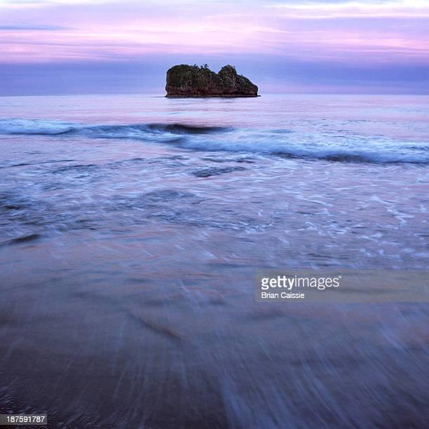 Seascape and island under a dusk sky