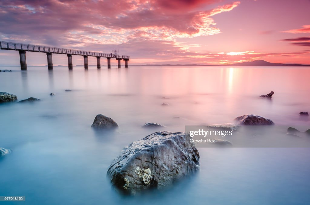 Seascape and Rangitoto Island at sunset, Murrays Bay, Auckland, New Zeland : Stock Photo