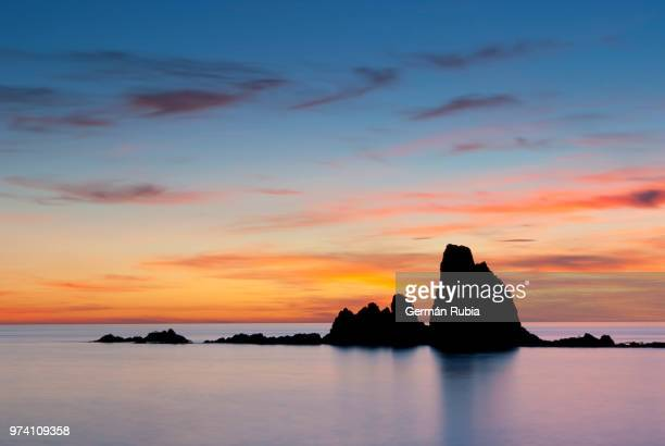 Seascape and rock formation at sunset, Cabodegata, Almeria, Spain