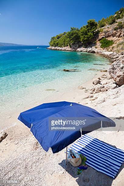 Seascape and sun umbrella