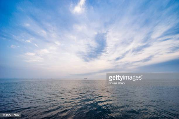 seascape at sunrise - atmospheric mood stock pictures, royalty-free photos & images