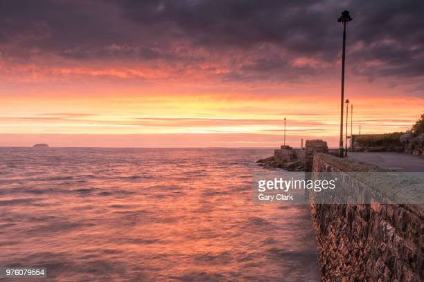 seascape at sunset, weston super mare, north somerset, england, uk - weston super mare stock pictures, royalty-free photos & images
