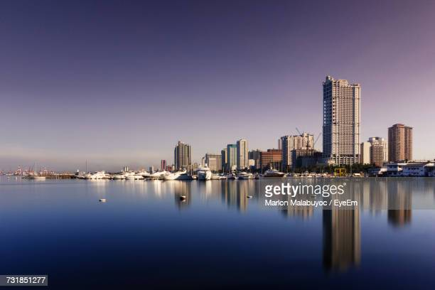 seascape by buildings against sky - manila philippines stock pictures, royalty-free photos & images