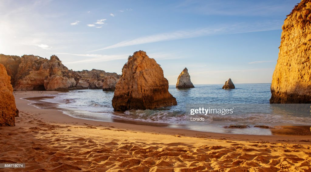 Seascape images of beach in Alvor Portugal in late summer sun : Stock Photo