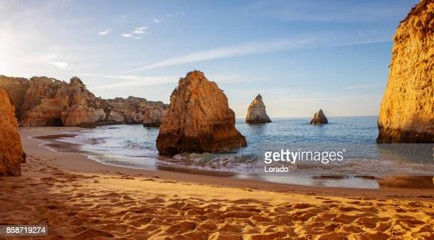 seascape images of beach in alvor portugal in late summer sun - algarve stock photos and pictures