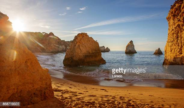 Seascape images of beach in Alvor Portugal in late summer sun