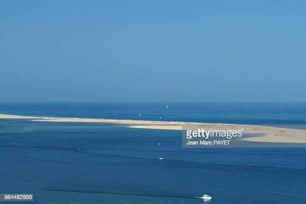 seascape, lagoon, sandbank and boat - jean marc payet stockfoto's en -beelden