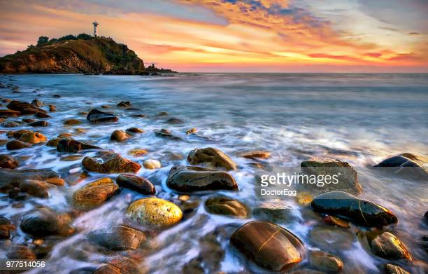 Seascape Lighthouse with Rock Beach at Lanta Island in Sunset, Krabi Province, Thailand