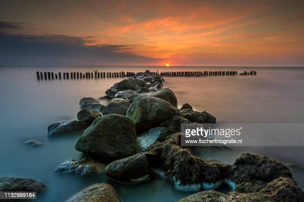 seascape, long exposure - zonsopgang stock pictures, royalty-free photos & images