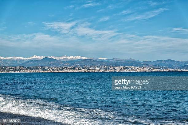 seascape, mountain with snow in french riviera - jean marc payet stockfoto's en -beelden
