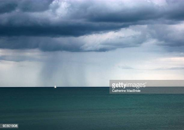 seascape with a single sailing boat - catherine macbride stock pictures, royalty-free photos & images