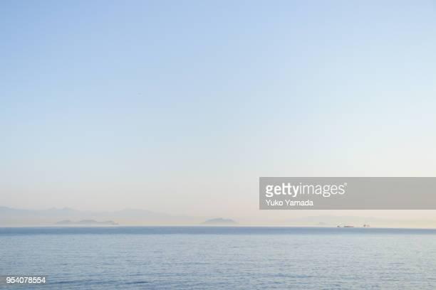 seascape with color gradient of sky at twilight - 静かな情景 ストックフォトと画像