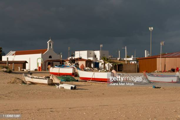 Seascape, with fishing boats and a hermitage in Islantilla.  Huelva  Spain