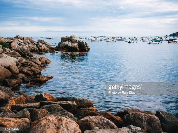 Seascape with rocks and boats