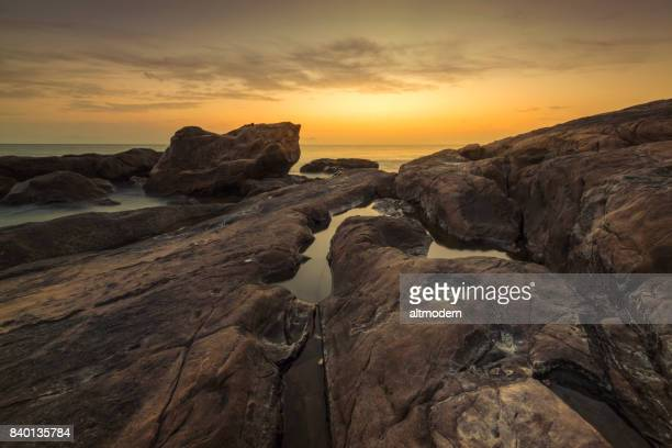 seascape with rocks at sunset in livorno tuskany italy - rocky coastline stock pictures, royalty-free photos & images