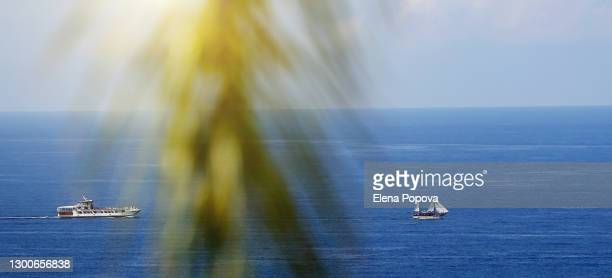seascape with white sailboat and yacht moving towards each other - seascape stock pictures, royalty-free photos & images