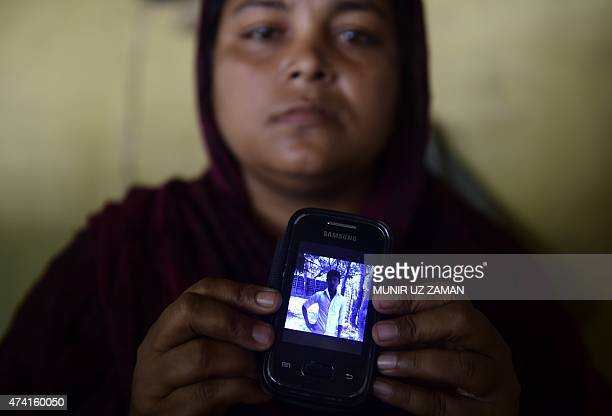 SEAsiamigrantsBangladeshpovertyFOCUS by Sam Jahan In this photograph taken on May 14 Bangladeshi villager Nurun Nahar poses with her cellphone in...