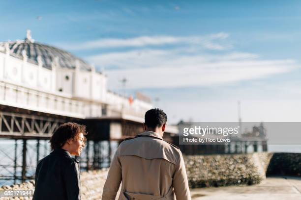seaside couples - town stock pictures, royalty-free photos & images