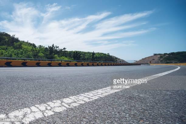 seaside highway - 境界線 ストックフォトと画像