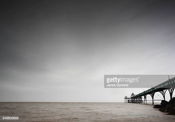 seaside pier on a gloomy day - clevedon pier stock pictures, royalty-free photos & images