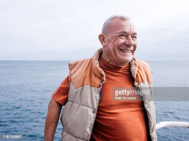 seaside portrait of old man - happiness stock pictures, royalty-free photos & images