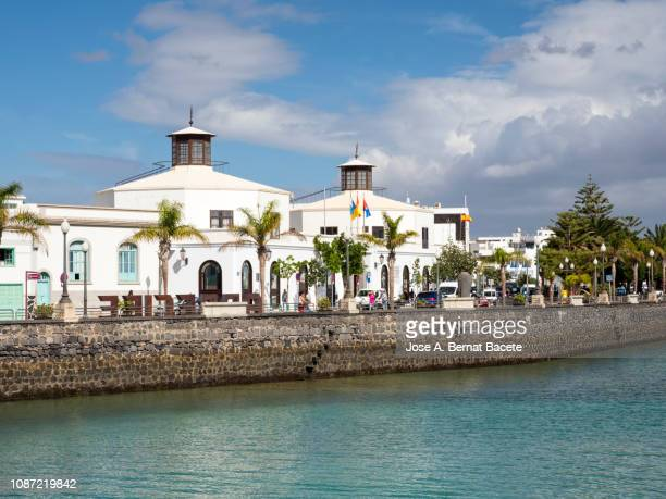 seaside promenade by the city of arrecife, in lanzarote , canary islands, spain. - arrecife stock photos and pictures