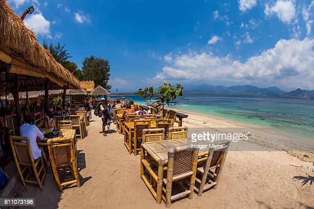 seaside restaurant in the gili islands in lombok, indonesia - gili trawangan stock photos and pictures