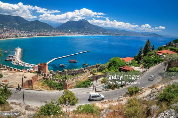 seaside road, alanya, antalya, turkey - antalya stock-fotos und bilder
