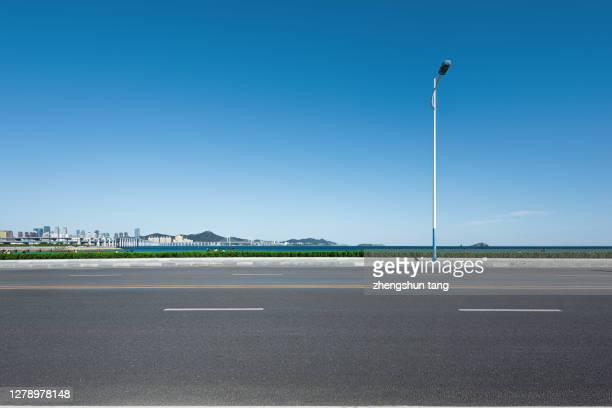 seaside roads - 人気のない道路 ストックフォトと画像