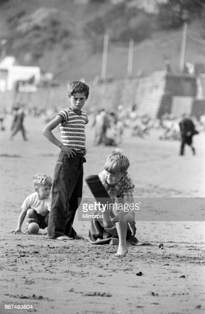 Seaside scenes in Scarborough, North Yorkshire, children playing cricket on the beach, 31st August 1958.