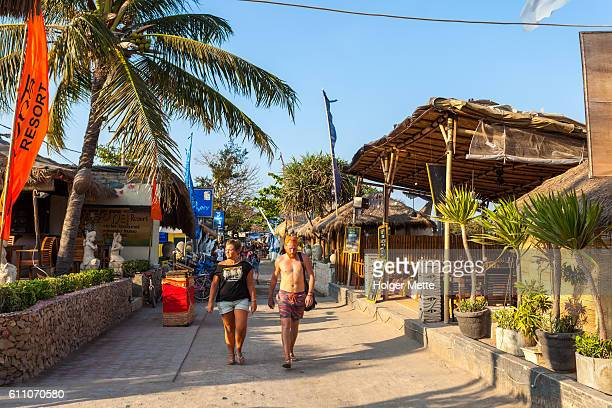 seaside street in the gili islands in lombok, indonesia - gili trawangan stock photos and pictures
