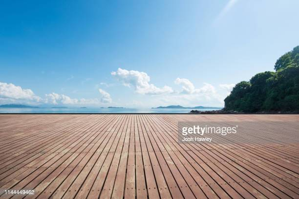 seaside wooden parking lot - standing water stock pictures, royalty-free photos & images
