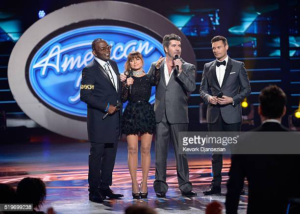 Season 1 judges Randy Jackson Paula Abdul Simon Cowell and host Ryan Seacrest speak onstage during FOX's American Idol Finale For The Farewell Season...