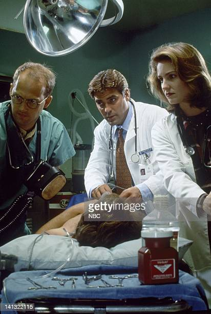 Season 1 -- Pictured: Anthony Edwards as Dr. Mark Greene, George Clooney as Dr. Doug Ross, Sherry Stringfield as ER Resident Dr. Susan Lewis -- Photo...