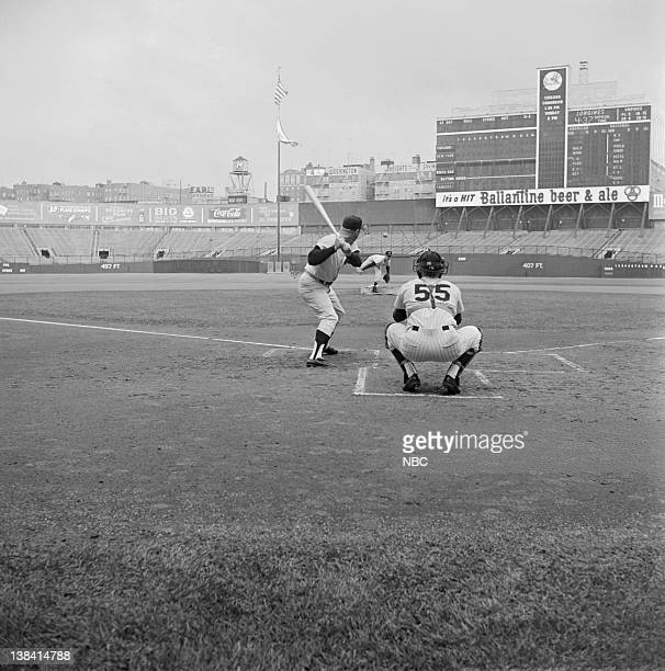 Johnny Carson pitches to Mickey Mantle Spudd Murray catching