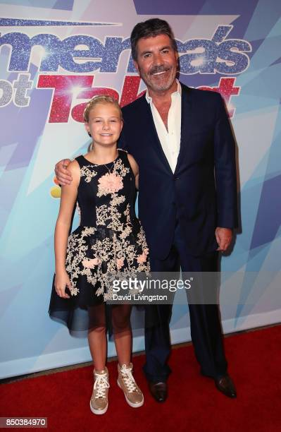 Season 12 winner ventriloquist Darci Lynne Farmer and judge/executive producer Simon Cowell attend NBC's 'America's Got Talent' season 12 finale at...