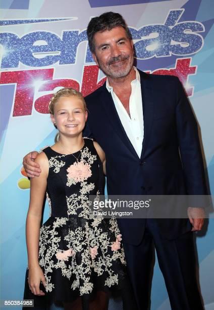 "Season 12 winner ventriloquist Darci Lynne Farmer and judge/executive producer Simon Cowell attend NBC's ""America's Got Talent"" season 12 finale at..."