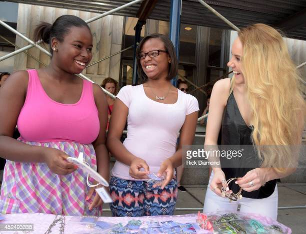 Season 4 winner of The Voice Danielle Bradbery helps teens in the style studio at the Threads For Teens Mobile Boutique Tour at Hotel Indigo...